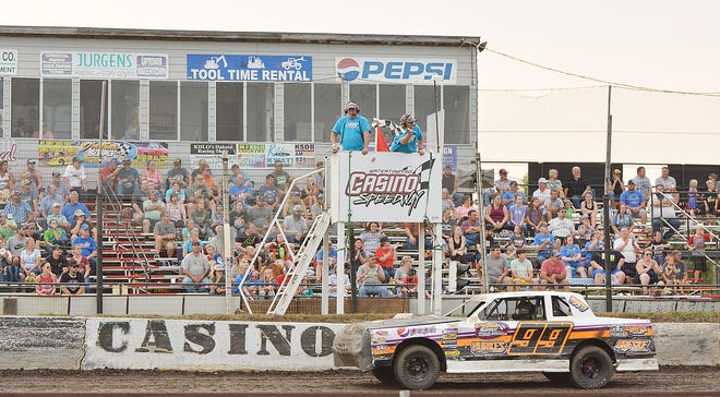 Street stock driver Andy Rossow of Florence takes the checkered flag in front a large group of grandstand fans during the latter stages of the 2020 racing season at Casino Speedway. The 67th season of racing at the local speedway is set to open Sunday with the Mother Day's Season Opener starting at 6:30 p.m.