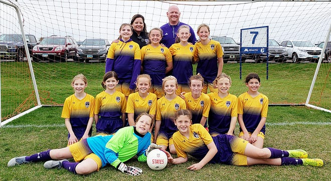 The Watertown Youth Soccer Association's U12 Girls Wildfire Gold team won its division over the weekend in the National Sports Center Spring Cup outdoor soccer tournament at Blaine, Minn. Team members include, from left in front, Maddie Kannas and Madison Enstad; Kyndal Bender, Jaelynn Weber, Sophia Wishard, Brooklynn Randall, Maryn York, Arianna Snyder and Bo Meidinger; third row, Maddie Carter, Olivia Dettmann, Khloe Landmark and Katie Fischer; and back, coach Koleen Randall and coach Justin Fischer. The U12 Boys Gold and U9-10 Girls Impacto Gold also won titles and four other WYSA teams attended — U9 Boys Gold, U10 Boys, U9/10 Impacto Purple, and U12 Boys Purple.