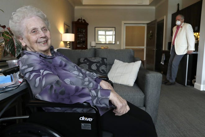 Bev Gericke, 83, lights up as she talks about seeing her son Dg Clearing, in back, and his siblings for the upcoming Mother's Day weekend. Clearing, who resides in Menasha, wrote a poem in honor of his mother, who lives at Century Oaks Assisted Living in Appleton.