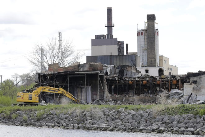 The city of Menasha is taking action to stabilize the former Whiting Paper Mill after Sunday's fire.