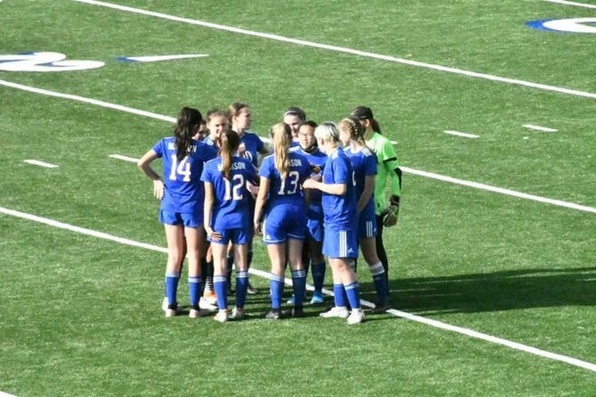 The Madison girls soccer team huddles up during its playoff loss to Salisbury on May 3. The team was down five players due to COVID-19 protocols.
