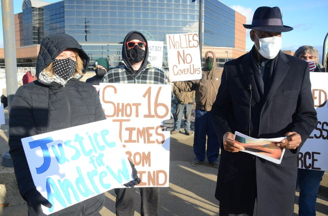 Charese Watson, right, and Attorney Leonard Mungo as a rally in December after Watson's son, Andrew Blowers, was shot and killed by police.