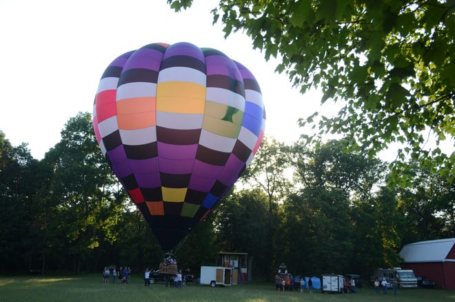 Tyler Jaques of Battle Creek, flying Brittney's Rainbow, will be one of the pilots this weekend at the first Nashville Balloon Festival.  (Trace Christenson/The Enquirer)