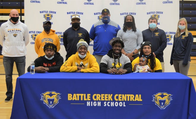 Four Battle Creek Central football players committed to play at Adrian College during a signing ceremony Thursday at Battle Creek Central High School, including, from left, Jacob Smith, Ravaunte Davis, Felix Shorter and Omarion Davis.