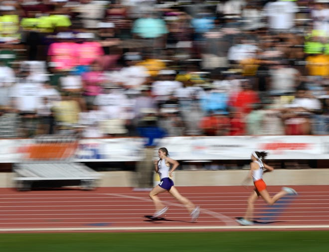 Canyon's Abree Winfrey, left, and Celina's Adele Clarke compete in the Class 4A girls 800-meter run during the UIL track and field state championships last Thursday at Mike A. Myers Stadium in Austin. Winfrey placed first with a time of 2:10.97.