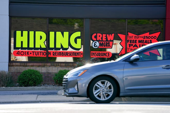 """A """"now hiring"""" marquee on display on a window of a Wendy's fast-food restaurant along Beechmont Avenue, Thursday, May 6, 2021, in the Mount Washington neighborhood of Cincinnati."""
