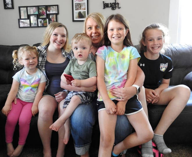 Carol Wakeley, center, is known as Supermom to many in the community for raising her four step-grandchildren. Her daughter, Reigan, left, couldn't be prouder and helps where she can with Paisleigh, 3, Tyson, 2, Adelynn, 9, and Brealeigh, 10.