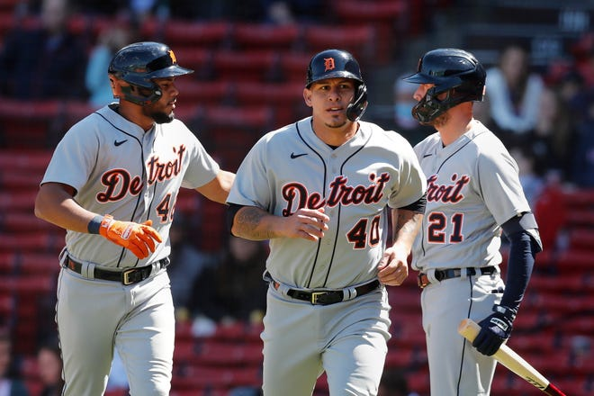 Detroit Tigers' Wilson Ramos (40) and Jeimer Candelario (46) celebrate with JaCoby Jones (21) after scoring on a double during the fourth inning against the Boston Red Sox, Thursday, May 6, 2021, in Boston.