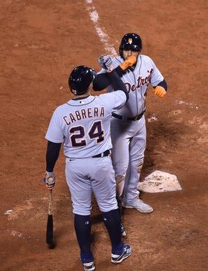 Jeimer Candelario celebrates his winning home run with Miguel Cabrera (24) on Wednesday night.