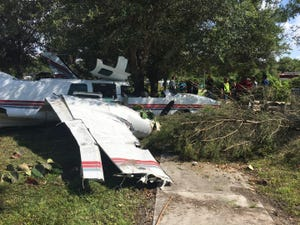 One person died and another was injured after this Piper 600 crash landed about 40 yards from the  the Good Shepard Episcopal Church in LaBelle about 3:20 p.m. Thursday.