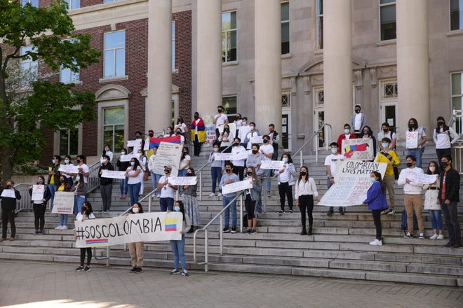 A group of Purdue University students gather on the steps of Frederick L. Hovde Hall of Administration to call attention to the ongoing turmoil in Colombia, Wednesday, May 5, 2021 in West Lafayette. For the eighth consecutive day, Colombians have continued protesting to demand an end to police abuse and the implementation of social policies to overcome the economic crisis resulting from the COVID-19 pandemic.
