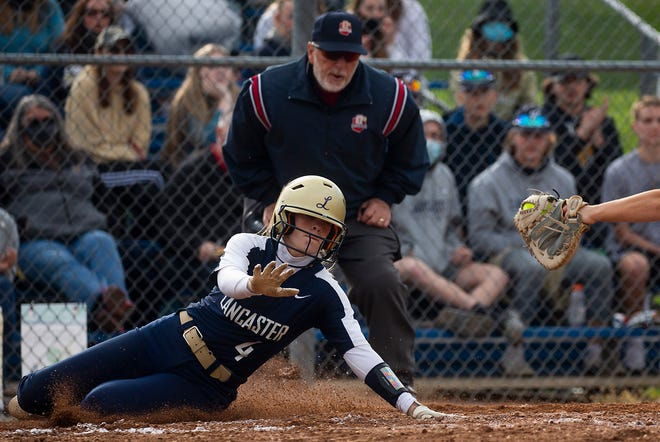 Lancaster's Lauren Kunzler (4) beats the attempted tag from the Cather as she slides into home plate against Pickerington Central during varsity softball at Lancaster High School in Lancaster, Ohio on May 5, 2021.