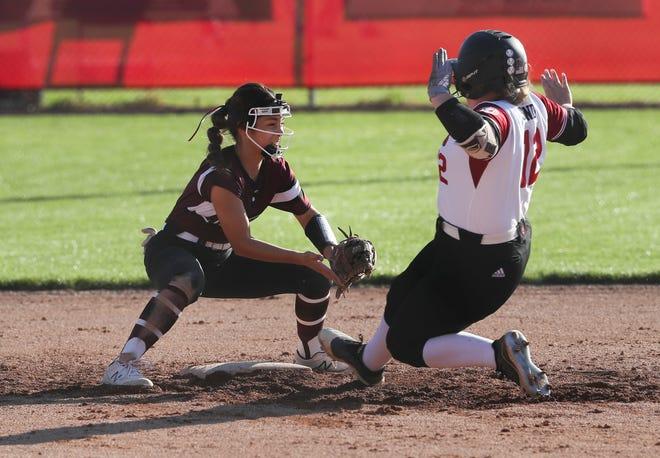 Assumption 's Emily Speaker (1) got the tag on Ballard's Taylor Sanders (12) at second base during their game at Ballard High School in Louisville, Ky. on May 5, 2021.  Ballard won 5-0.
