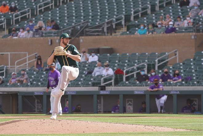 Jeff Criswell pitches during a spring training contest. The Lansing Lugnuts pitcher and Portage native is following in the footsteps of his father by pitching in the Oakland A's minor league system.