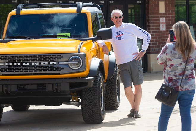 Phil Chandler has his wife take his photo with a Ford Bronco at the Greater Milwaukee Car & Truck Show Wednesday, May 5, 2021, at the Wisconsin Exposition Center at State Fair Park in West Allis, Wis. The Chandlers are waiting for the delivery of their SUV and are from Rockton, Illinois. Normally held in February at the Wisconsin Center in downtown Milwaukee, the show has a temporary location change brought about by the COVID-19 pandemic.