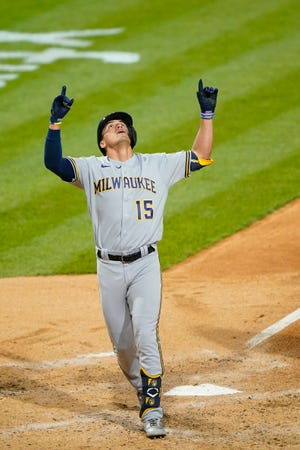 Tyrone Taylor of the Brewers points and looks skyward after hitting a solo home run against the Phillies in the fifth inning.