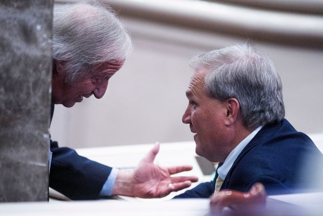 Rep. Mike Ball (left) and Senator Tim Melson chat after the medical cannabis bill was passed in the House Chamber of the Alabama Statehouse in Montgomery, Ala., Thursday, May 6, 2021.