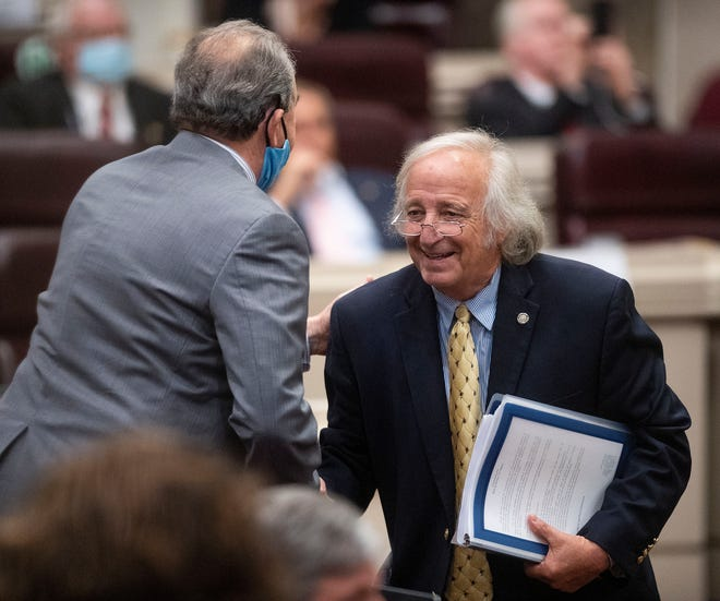 Rep. Mike Ball is congratulated after the medical cannabis bill is received at the Alabama Statehouse home in Montgomery, Ala. On Thursday, May 6, 2021.