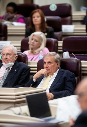 Sen. Tim Melson watches debate on the Medical Cannabis bill in the house chamber at the Alabama Statehouse in Montgomery, Ala., on Thursday May 6, 2021.