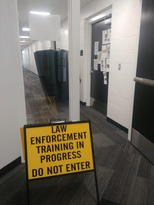 Sign in Adena Hall warning of police officer training