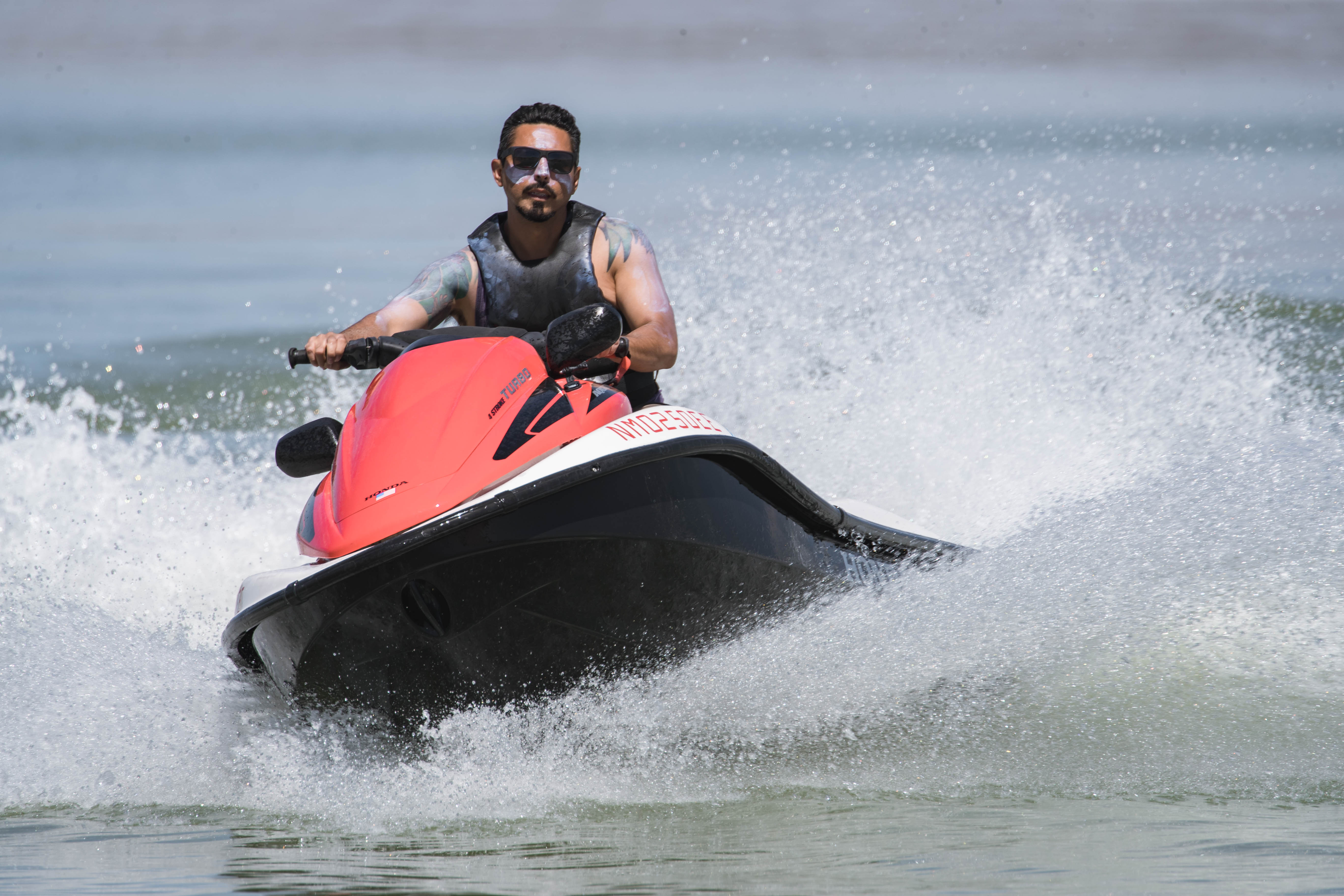 Ruben Apodaca drives a jet ski at Elephant Butte Dam State Park in Elephant Butte on Thursday, May 6, 2021.