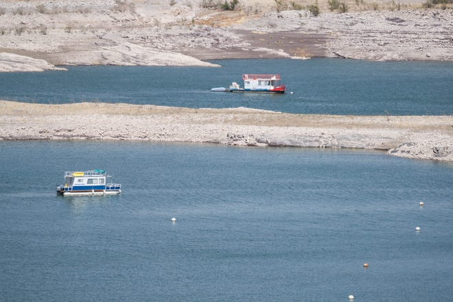 Pontoon boats are pictured at Elephant Butte Dam State Park in Elephant Butte on Thursday, May 6, 2021.