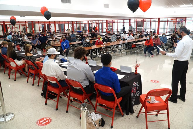 Staff, students and family members gather at Livonia Churchill High on May 6, 2021 to celebrate those student-athletes signing National Letters of Intent.