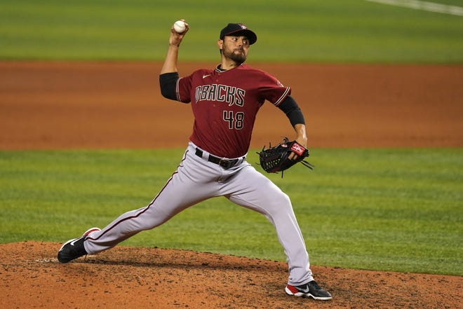 May 5, 2021; Miami, Florida, USA; Arizona Diamondbacks relief pitcher Joakim Soria (48) delivers a pitch in the 7th inning against the Miami Marlins at loanDepot park. Mandatory Credit: Jasen Vinlove-USA TODAY Sports