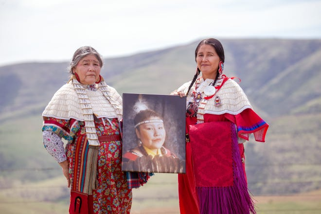 Mildred Quaempts, right, and Merle Kirk hold a portrait of Mavis Kirk-Greeley, who died in 2009 when her boyfriend deliberately hit her with his vehicle on the Warm Springs Indian Reservation. Kirk-Greeley is Quaempts' daughter and Kirk's sister.