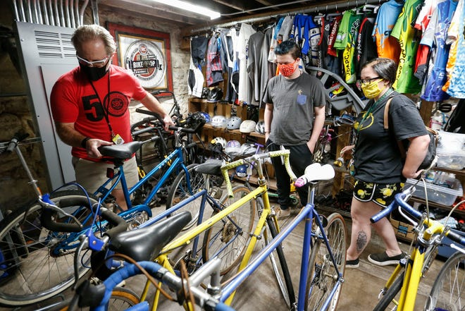 Neil Chanter (left), founder of the Springfield Brewing Company Community Bike Shop at the Fairbanks, help Jamison Wilmoth and Savannah Mazzola pick out a bike on Wednesday, May 5, 2021.
