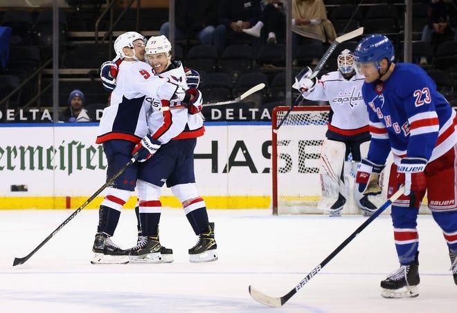 Washington Capitals forward T.J. Oshie celebrates his hat trick goal vs. the New York Rangers.