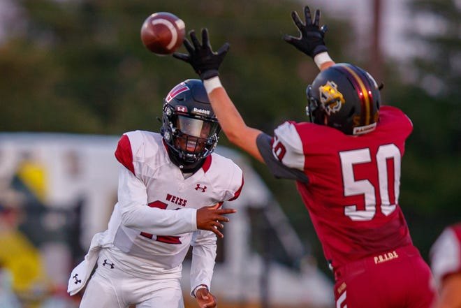 Weiss quarterback Dior Bradfield gets a pass off in time against Rouse during a game last season. The Wolves are No. 9 in the American-Statesman's preseason Top 10 poll.