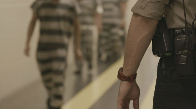 Inmates walk through the Travis County jail. Photo courtesy of the Travis County Sheriff's Office.