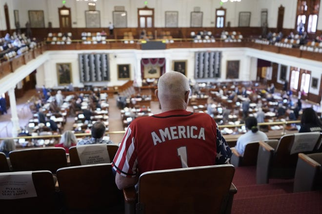 Gerald Welty sits in House Chamber at the Texas Capitol on Thursday as he waits to hear debate on legislation that would make it harder for Texans to vote.