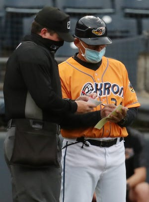 RubberDucks manager Rouglas Odor is relying on a group of veteran players he has managed before to help him get his ideas across to the younger players on the team. [Mike Cardew/Beacon Journal]