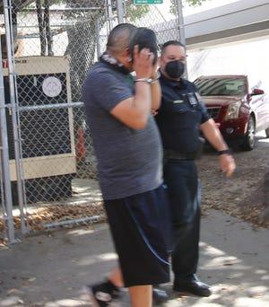 Sgt. Orlando Jasso escorts Cruz Alonzo Jr. to the JWC jail.