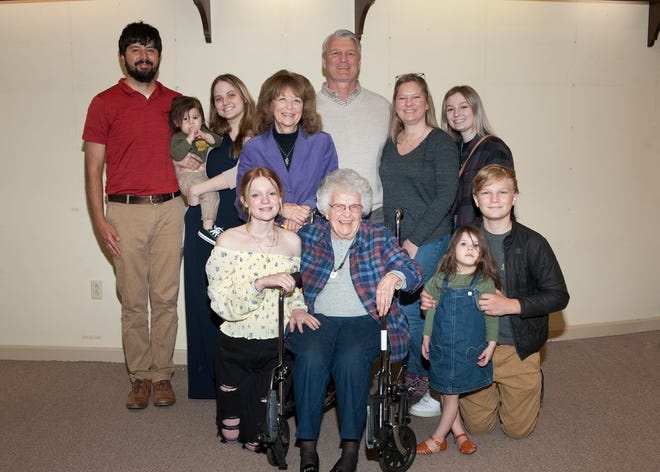Peggy Brill, seated at center, had family and friends on hand April 30 when her Lingenfelter-Brill retail shop closed for the last time.