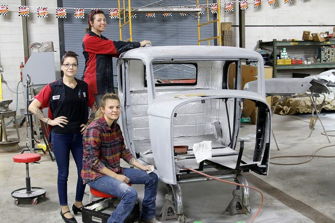 Kandi McCrea, left, poses with her two female employees at Kandi's Rods & Kustoms Cheyenne Johnson, center, who has worked there for five years and intern Liberty Kirvel on Friday, May 7, 2021. TOM E. PUSKAR/TIMES-GAZETTE.COM