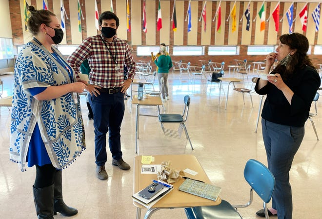 Liz Freedman, right, chats with Meaghan O'Connor and Ian Maguire of the BHS Music Department after spending the day onsite.
