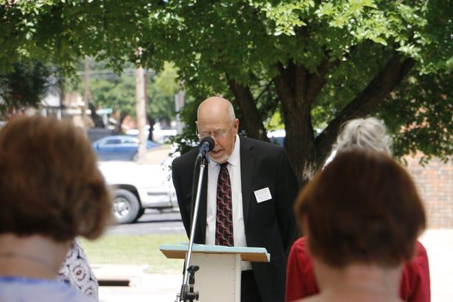 Early Mayor Pro Tem Benny Allcorn leads a prayer Thursday at the Stuart and Margaret Coleman Plaza in Brownwood.