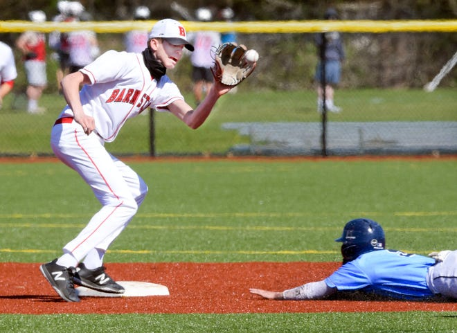 Barnstable shortstop Coley Buckler takes the throw as Joe Morrison of Sandwich slides safely into second.