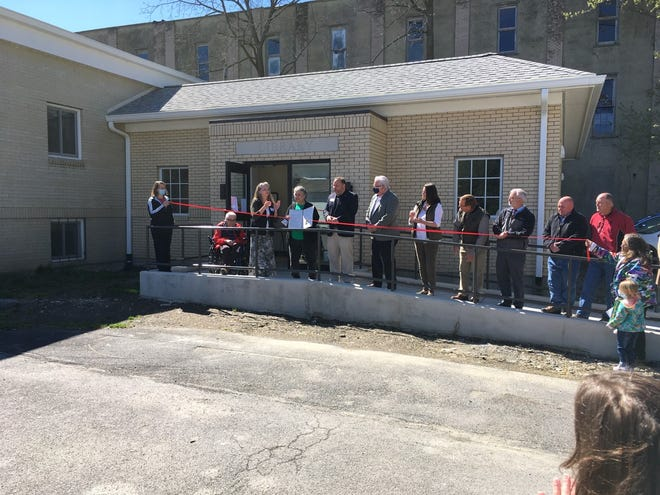 The ribbon cutting for the new Dundee Library wing attracted the community and State Senator Tom O'Mara and Assemblyman Phil Palmesano, who presented a state Legislature proclamation to Library Director Linda Nichols.