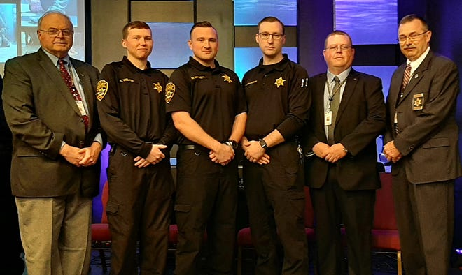 Yates County Sheriff Ron Spike congratulates Corrections OfficersKyle Welker,Marcus Mallett,and Christopher Spaulding, on their graduation from Correction Officer Basic School in Seneca County; along with Chief CO Jarred Bailey and Undersheriff Howard Davis.