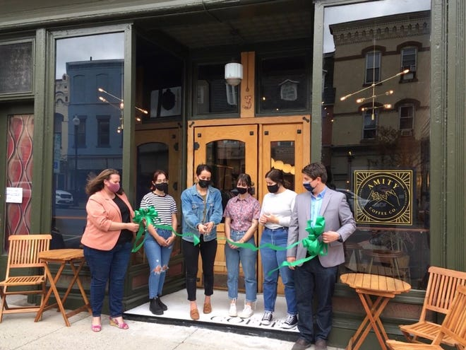 Amity Coffee Co. owner Lyndsi Stoltzfus cuts the ribbon at the new location, No. 3 Main St. in Penn Yan, flanked by her staff and ribbon holders Jessica Bacher of the Yates County Chamber of Commerce and Mike Lipari of the Finger Lakes Economic Development Center.