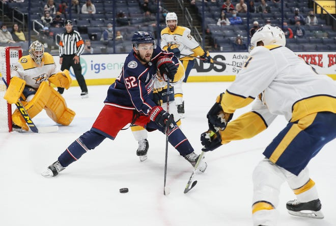 Blue Jackets center Emil Bemstrom braces himself for impact with Nashville defenseman Ryan Ellis on Wednesday. Before his hat trick in Wednesday's game, Bemstrom had a goal drought thatextendedbackto the final game of last season.