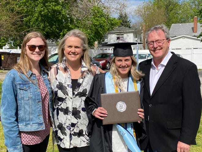 From left, Cameron, Kristen, Chelsea and Marcus Atha attend Chelsea's graduation from Bowling Green State University on May 2. The Athas are attending three college graduation ceremonies in three weeks.