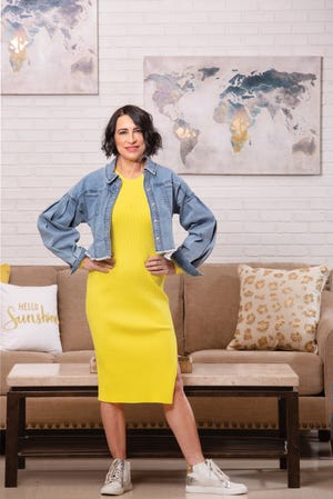 Kris Hays is wearing INC International Concepts yellow dress, $119.50; INC International Concepts jean jacket, $99.50; high-top sneakers with yellow stripe and leopard, $69 (all from Macy's)