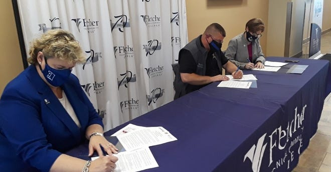 Signing the agreement Friday to provide job training for Terrebonne jail inmates are (from left) Jodee Daroca, president and CEO of Goodwill Industries of Southeastern Louisiana, Sheriff Tim Soignet and Fletcher Technical Community College Chancellor Kristine Strickland.