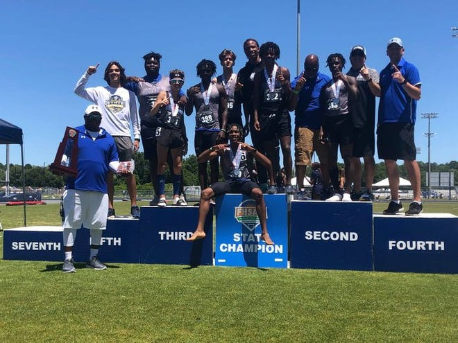 The Mount Dora Christian Academy boys track team celebrates Friday after winning the FHSAA Class 1A state title in Jacksonville.