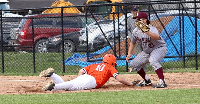 Meadowbrook's Josh Hupp (10) dives back to first base with John Glenn first baseman Gunner Fox taking the throw during the MVL baseball game at Meadowbrook Thursday evening.